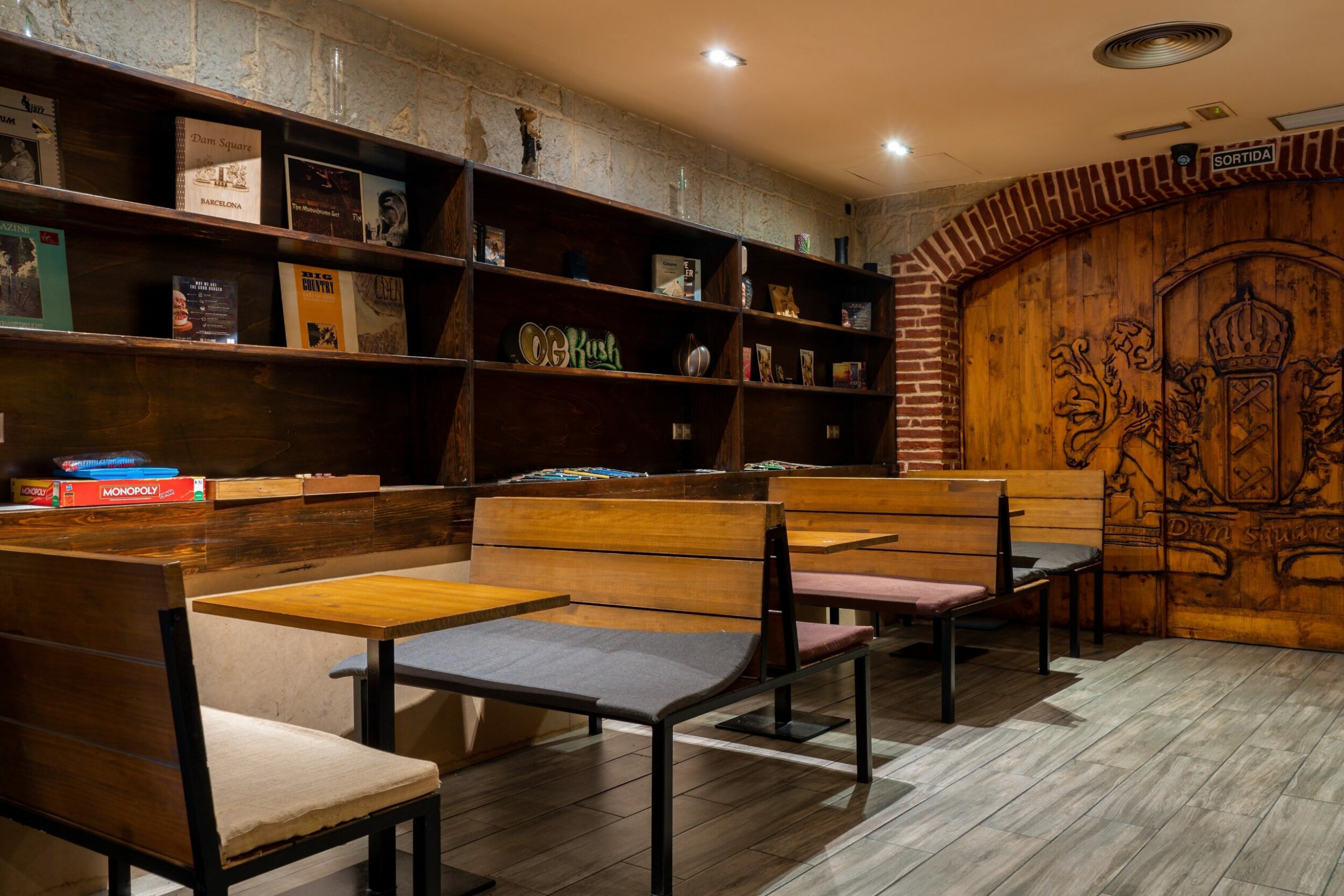 the entrance door and wooden tables in the cannabis club